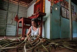 編織草蓆為生