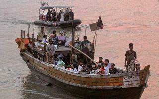 海岸巡防攔截難民船